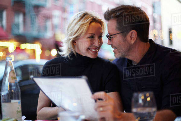 Caucasian couple eating at urban cafe, New York City, New York, United States Royalty-free stock photo