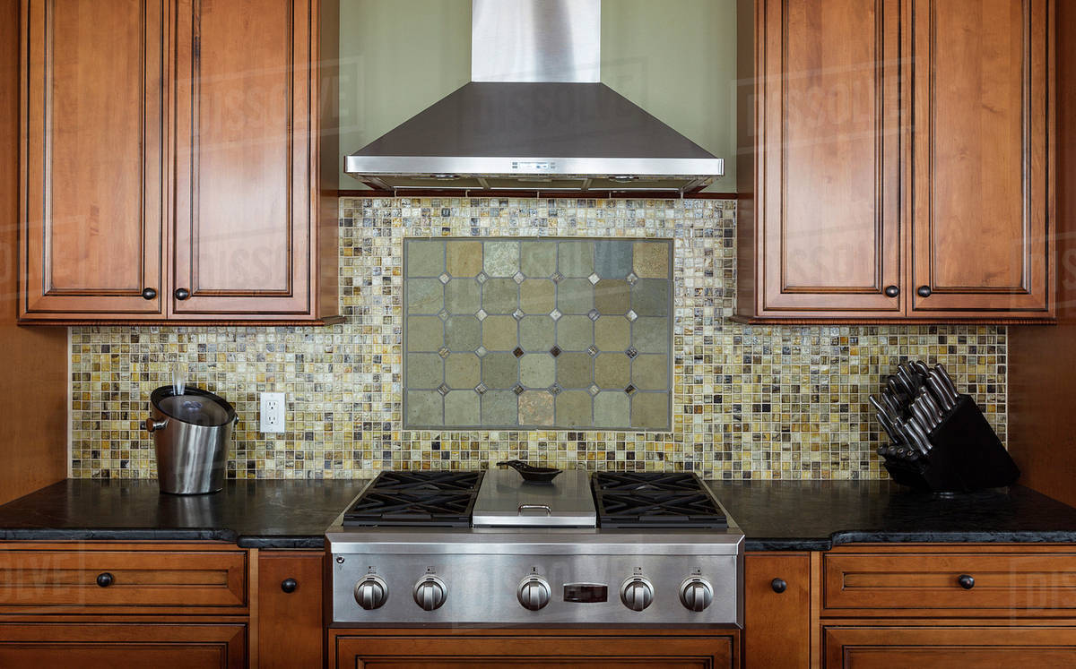 Tile Back Splash Ventilation Hood And Stove In Kitchen Stock Photo Dissolve