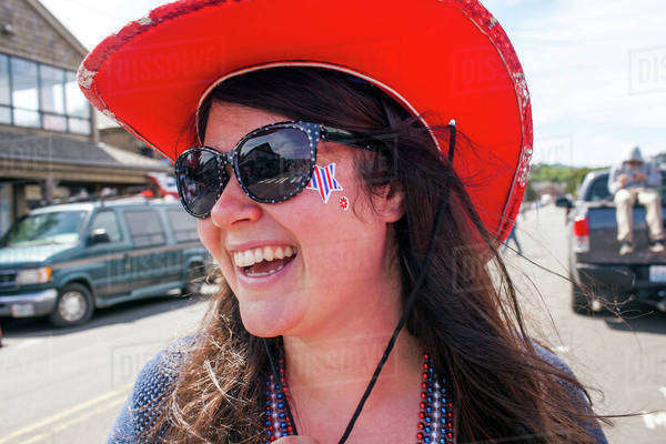 Caucasian woman wearing cowboy hat and face paint in street Royalty-free stock photo