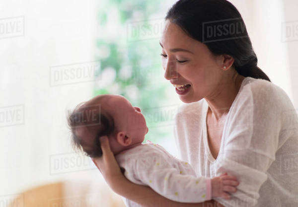 Asian mother holding baby Royalty-free stock photo