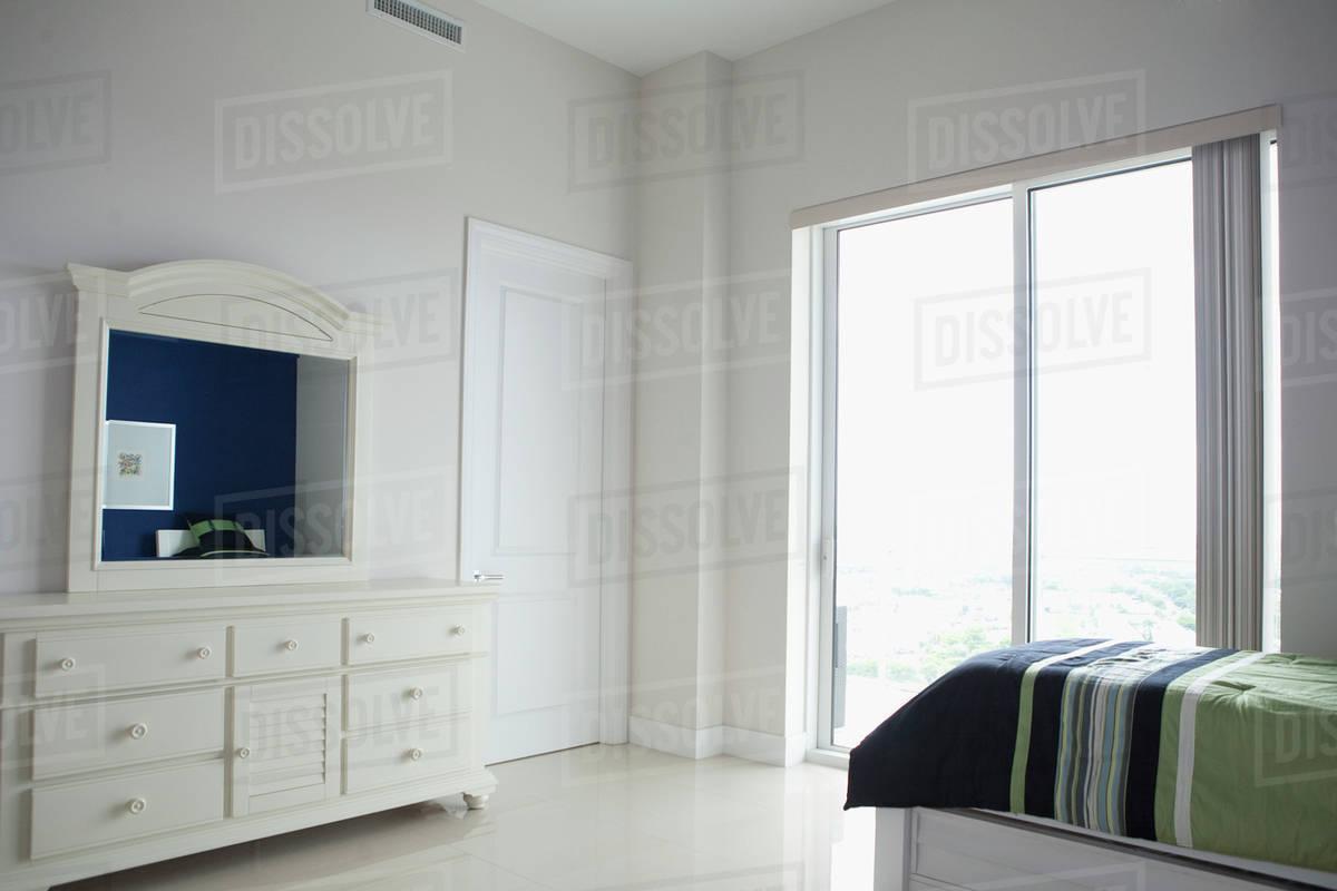 Dresser Mirror And Windows In Modern Bedroom Stock Photo Dissolve