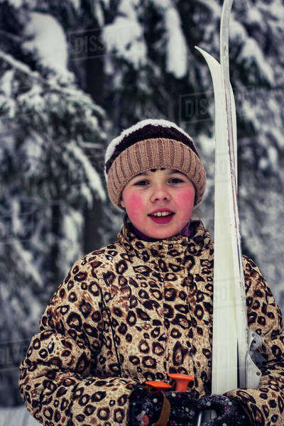 Caucasian girl carrying skis in forest Royalty-free stock photo