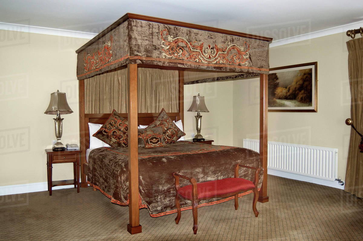 Picture of: An Antique Style Four Poster Bed With Drapes And Curtains Stock Photo Dissolve