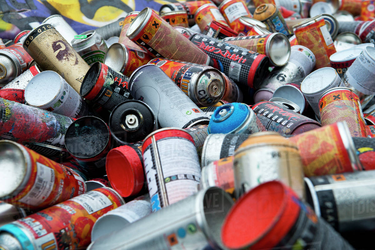Close up of pile of spray paint cans stock photo