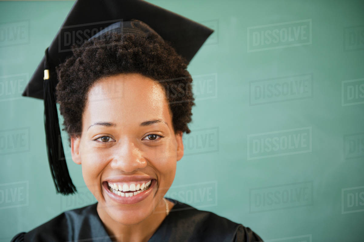 African American woman in graduation cap and gown - Stock Photo ...