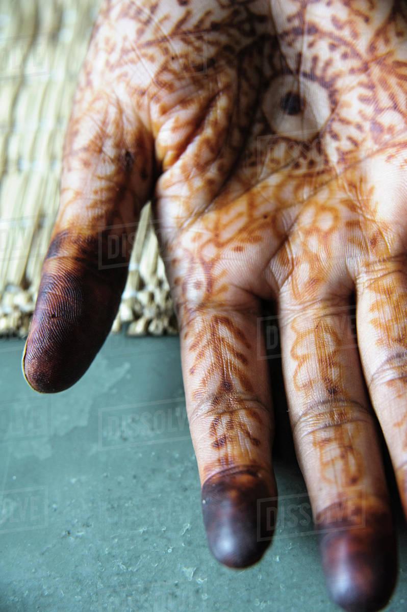 95dff0772 Close up of tattooed hand - Stock Photo - Dissolve