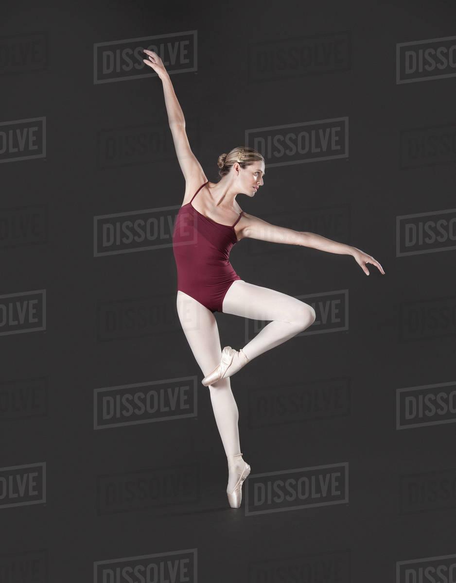 Caucasian Ballet Dancer Posing On Pointe Stock Photo Dissolve
