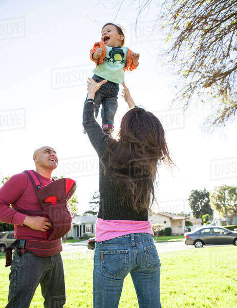 Low angle view of Hispanic family playing in park Royalty-free stock photo