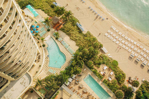 Aerial view of hotel pools and tropical beach Royalty-free stock photo
