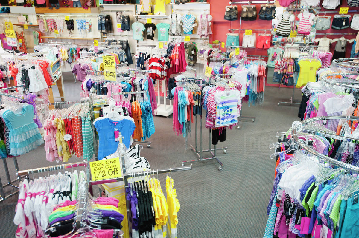 bee569ce982 Children s clothing on racks in store - Stock Photo - Dissolve