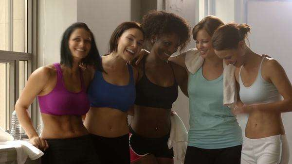 Multi-ethnic women hugging and laughing after working out Royalty-free stock video