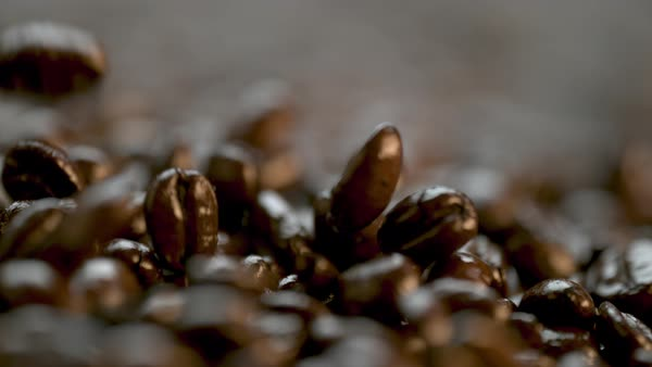 Extreme close-up shot of coffee beans falling Rights-managed stock video
