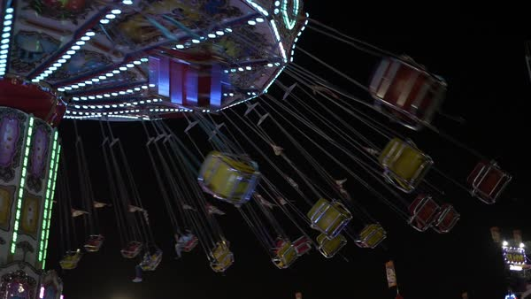 Slow motion shot of a spinning swing ride Royalty-free stock video