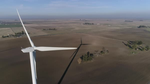 Aerial shot of a wind turbine in a field on Montezuma Hills Royalty-free stock video