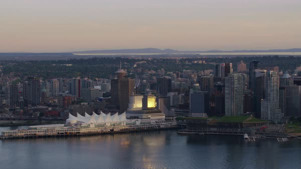 Aerial shot of modern Vancouver cityscape with Canada Place, Harbour Centre and BC Place at Burrard Inlet, British Columbia, Canada Rights-managed stock video