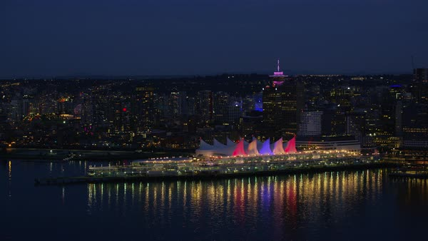 Aerial shot of Canada Place illuminated with Harbour Center and BC Place in background, Vancouver, British Columbia, Canada Rights-managed stock video