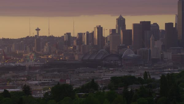 Aerial shot of Seattle cityscape with Seattle Great Wheel and Space Needle at dusk, Washington, United States of America Rights-managed stock video