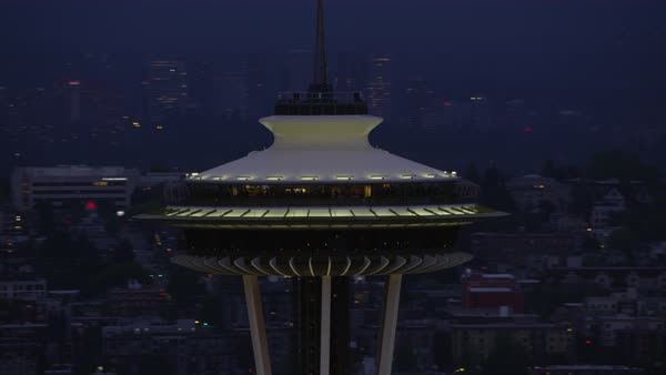 Dolly shot of Space Needle tower with modern Seattle cityscape at night, Washington, United States of America Rights-managed stock video