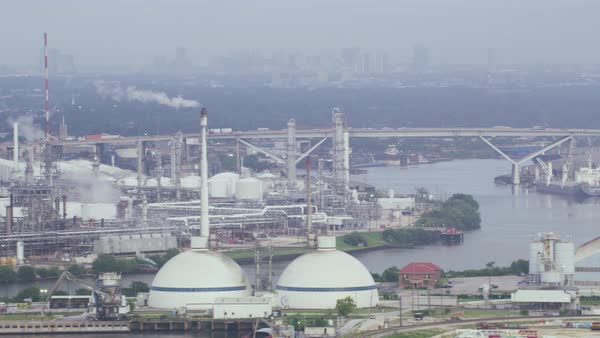 Aerial shot of refinery, Sidney Sherman bridge in background, Deer Park, Texas, United States of America Rights-managed stock video