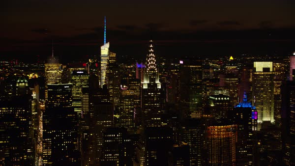 Aerial shot of Manhattan cityscape with Chrysler Building at night Rights-managed stock video