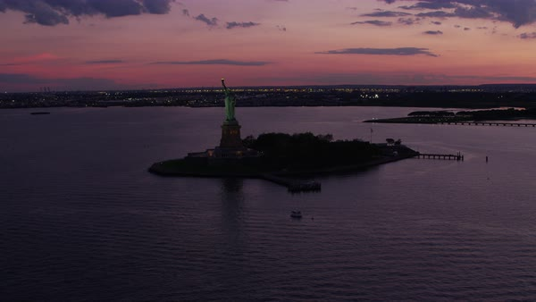 Aerial shot of Statue of Liberty at sunset Rights-managed stock video