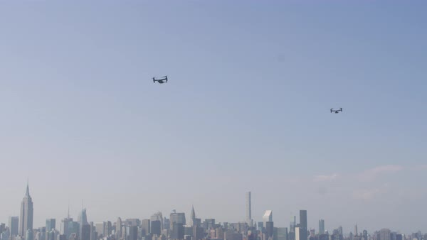 Tracking shot of tilt-rotor aircraft flying above New York City skyline Rights-managed stock video
