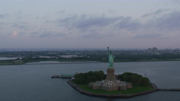 Aerial shot of Statue of Liberty with New York cityscape in background Rights-managed stock video