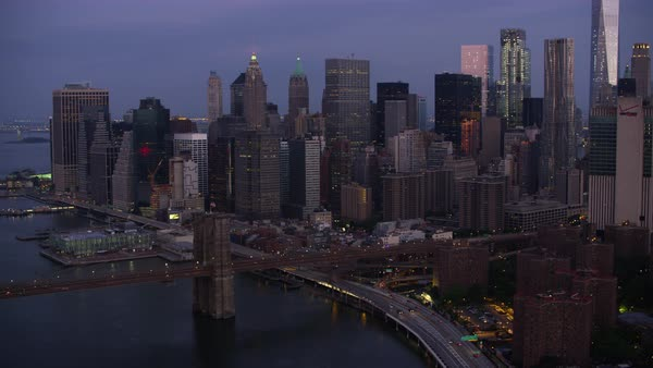 Aerial shot of Lower Manhattan cityscape with Brooklyn Bridge Rights-managed stock video