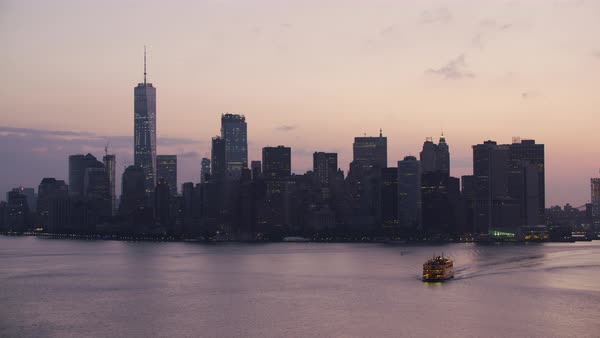 Aerial shot of a Staten Island Ferry with Manhattan skyline in background Rights-managed stock video