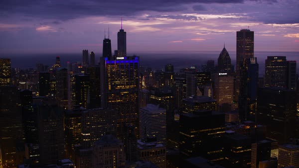 Aerial shot of skyscrapers in downtown Chicago at sunrise, with the Willis Tower in the foreground Rights-managed stock video