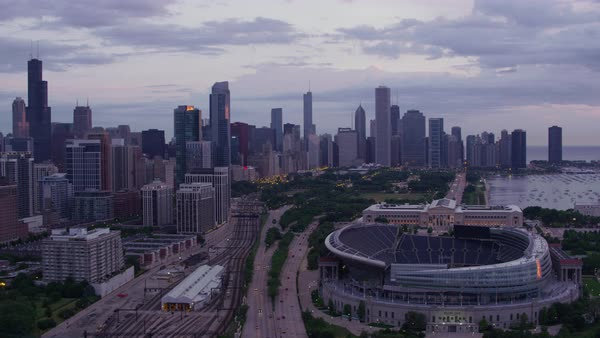Aerial shot of downtown Chicago skyline, flying over Soldier Field, the Field Museum and Grant Park Rights-managed stock video