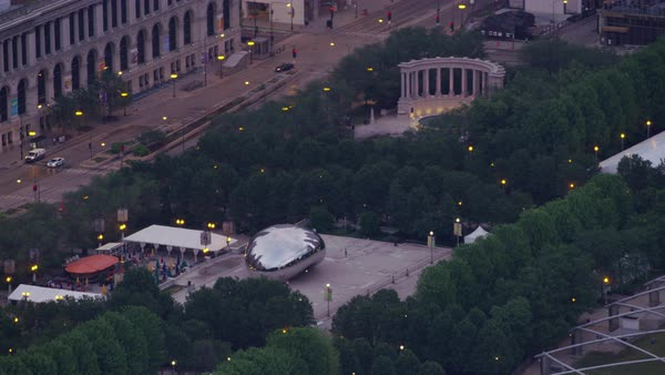 Aerial shot of Millennium Park in downtown Chicago, zooming out to reveal more downtown Chicago architecture  Rights-managed stock video