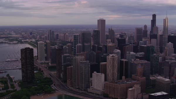 Aerial shot of downtown Chicago skyline seen from above Lake Michigan Rights-managed stock video