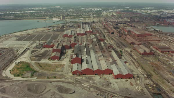 Aerial shot of an industrial complex on waterfront Rights-managed stock video