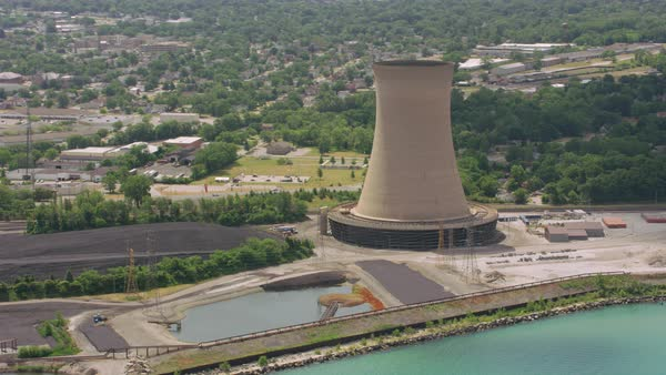 Aerial shot of a power plant with a cooling tower Rights-managed stock video