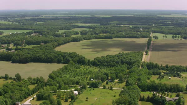 Aerial shot of a rural area with farmlands and forests Rights-managed stock video