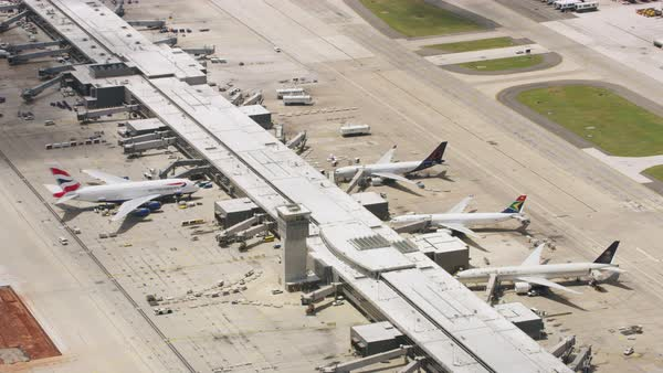 Aerial shot of airplanes parking at an airport in Washington DC Rights-managed stock video