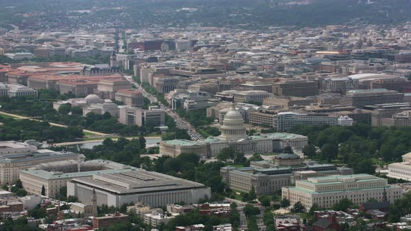Aerial shot of the Capitol building with Washington DC cityscape Rights-managed stock video