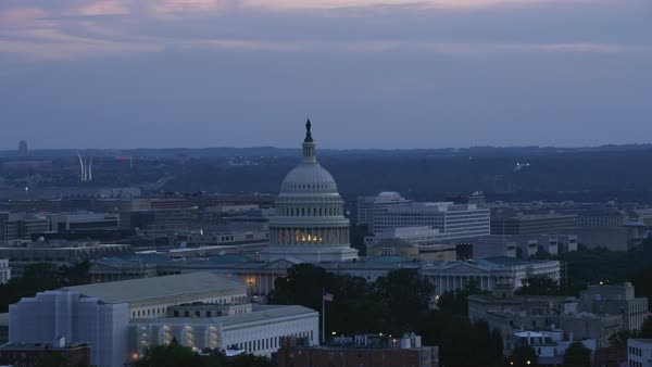 Aerial shot of United States Capitol with Washington Monument in background at dusk Rights-managed stock video