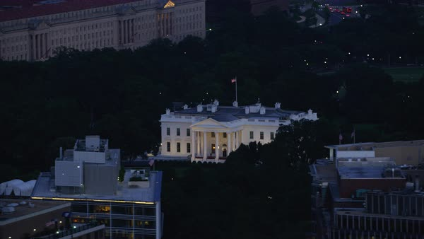 Aerial shot of illuminated White House at dusk Rights-managed stock video
