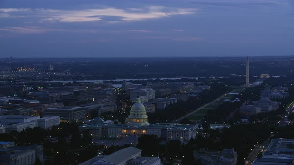 Aerial shot of United States Capitol with Washington Monument at dusk Rights-managed stock video
