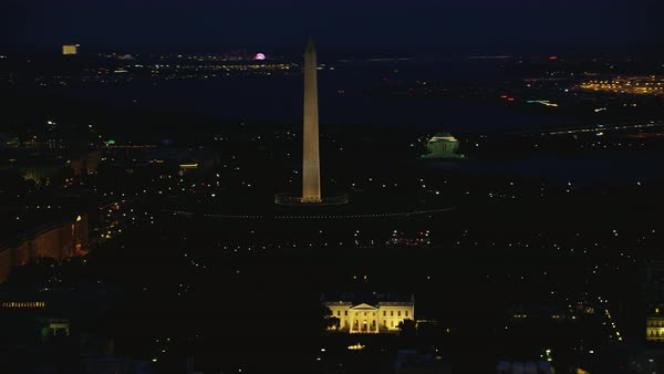 Aerial shot of the White House, Washington Monument and Jefferson Memorial illuminated at night Rights-managed stock video