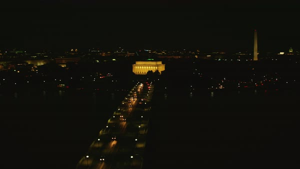 Aerial shot of Arlington Memorial Bridge and Lincoln Memorial at night Rights-managed stock video