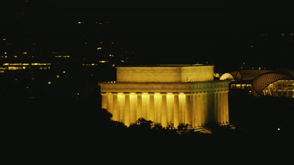 Aerial shot of Lincoln Memorial in Washington DC illuminated at night Rights-managed stock video
