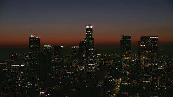 Aerial shot of skyscrapers of downtown Los Angeles at sunset Rights-managed stock video