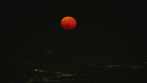 Aerial shot of red colored full moon above Los Angeles Rights-managed stock video