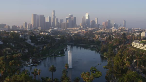 Aerial shot of Echo Park with downtown Los Angeles skyline in background Rights-managed stock video