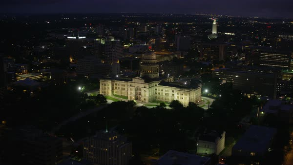 Texas State Capitol Building with cityscape at night Rights-managed stock video