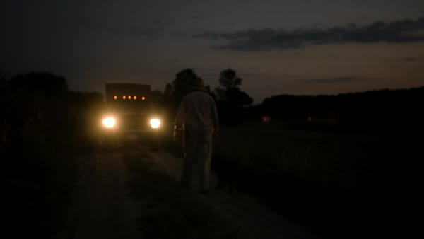Static shot of a farmer walking to his truck with his dog Royalty-free stock video