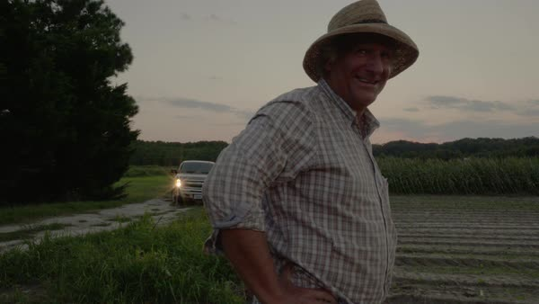 Static shot of a laughing farmer standing on a crop field Royalty-free stock video